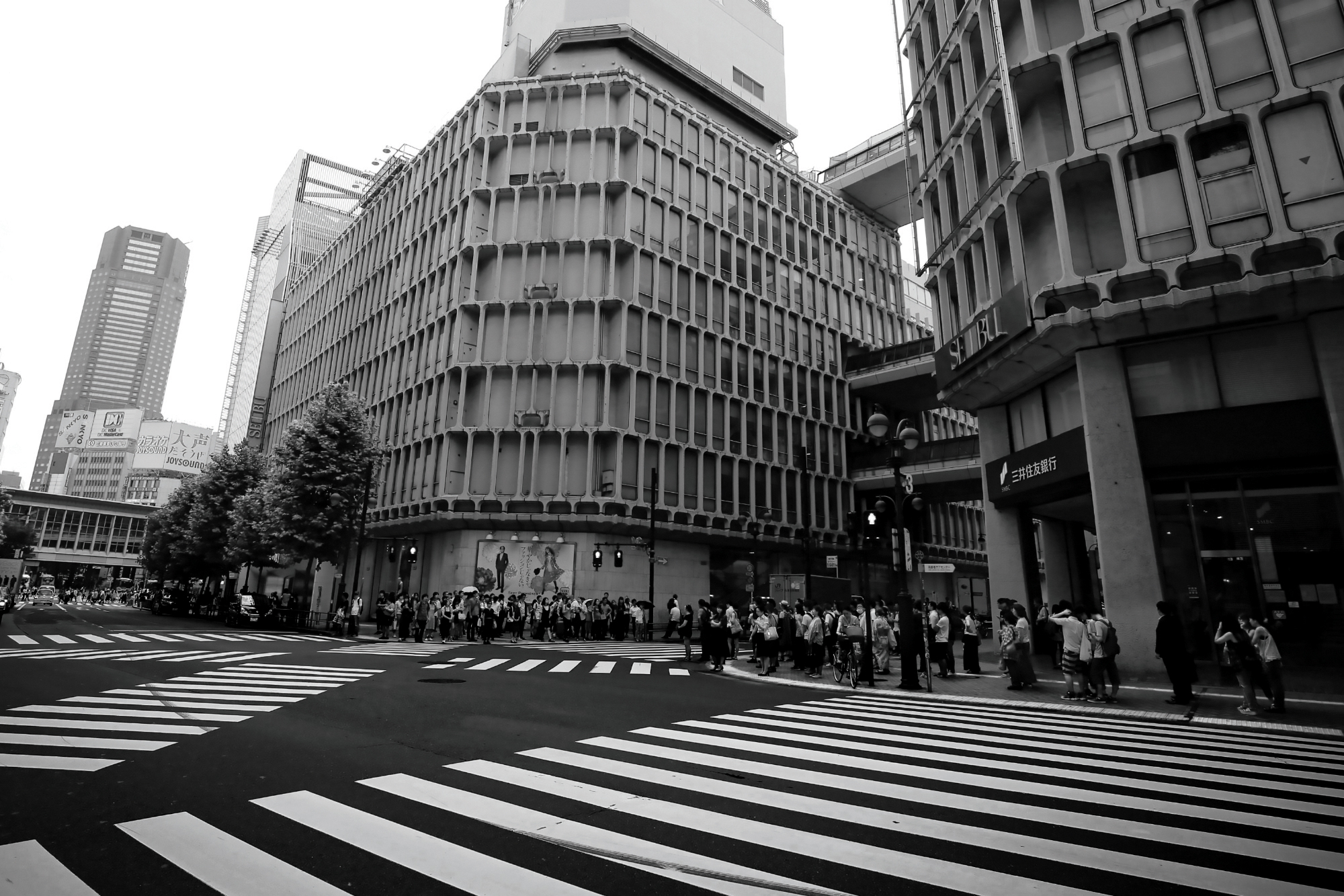 Black and white photograph taken of a street in Tokyo, Japan with many different crosswalk options on the road