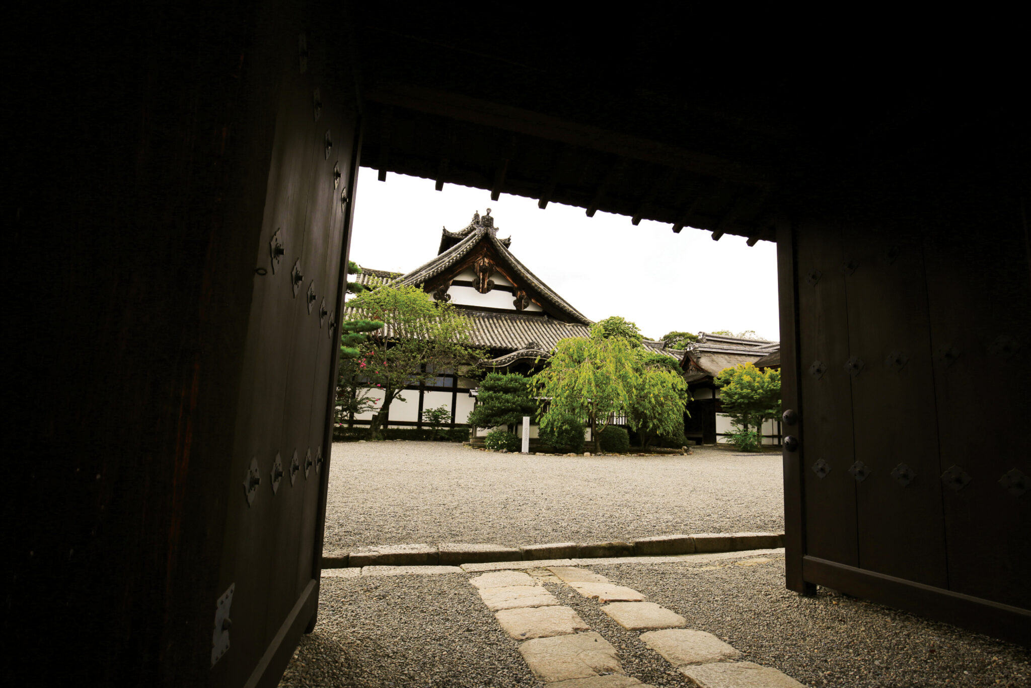 Dark but warm photograph taken at the entrance of a temple. Photograph was taken in Kyoto, Japan
