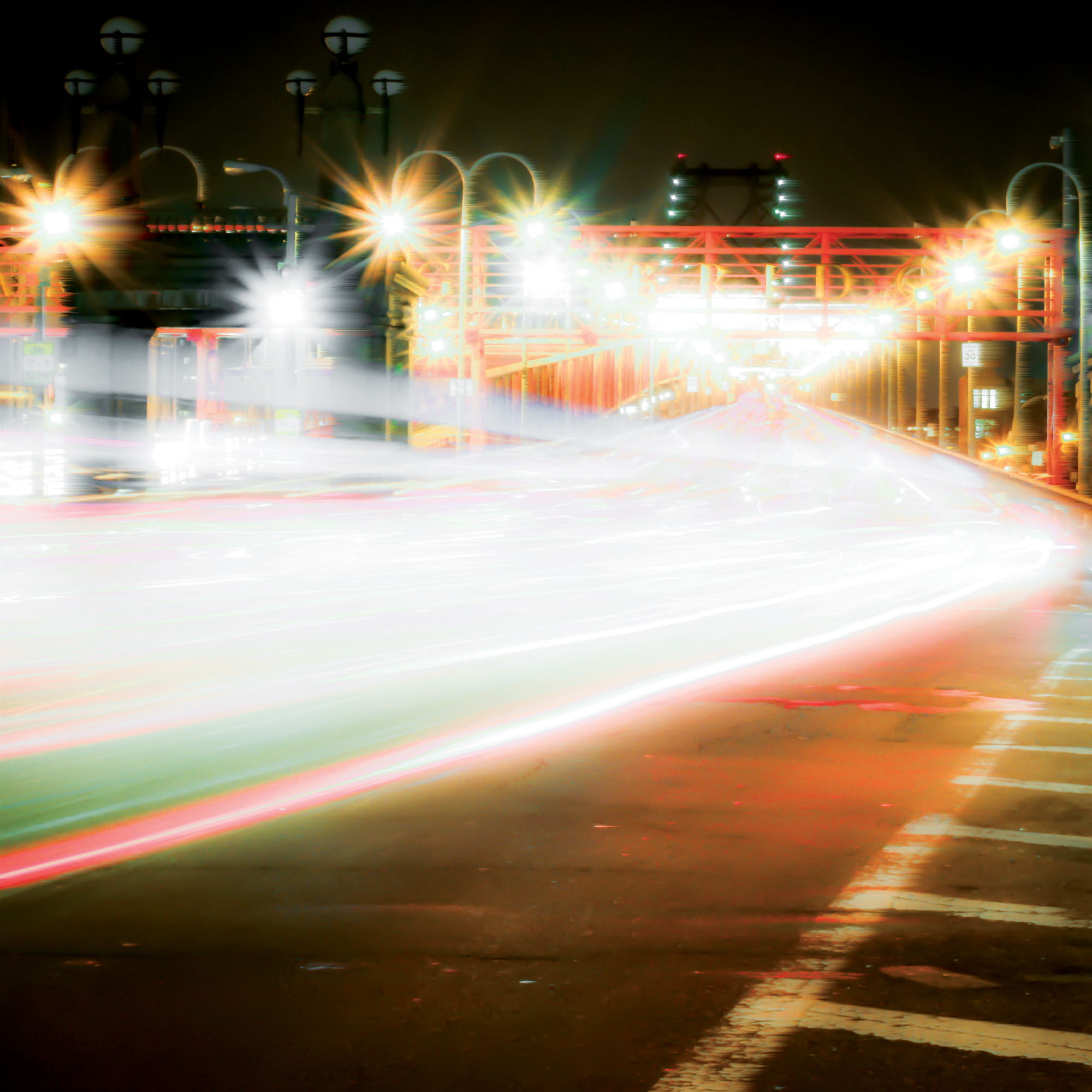 Long exposure photograph taken in the Lower East Side in Manhattan, New York, Taken at night of cars driving by near the Williamsburg Bridge